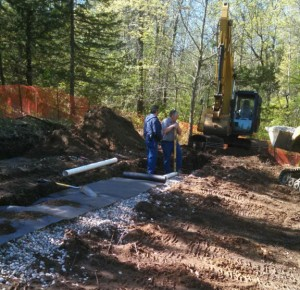 Glen Kothrade and Tim K Installing Drainfield May 2, 2016